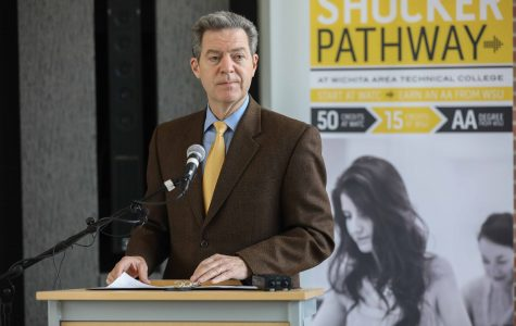 Gov. Brownback signs bill to join WSU, WATC