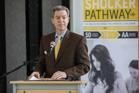 Gov. Brownback signs bill to join WSU, WATC