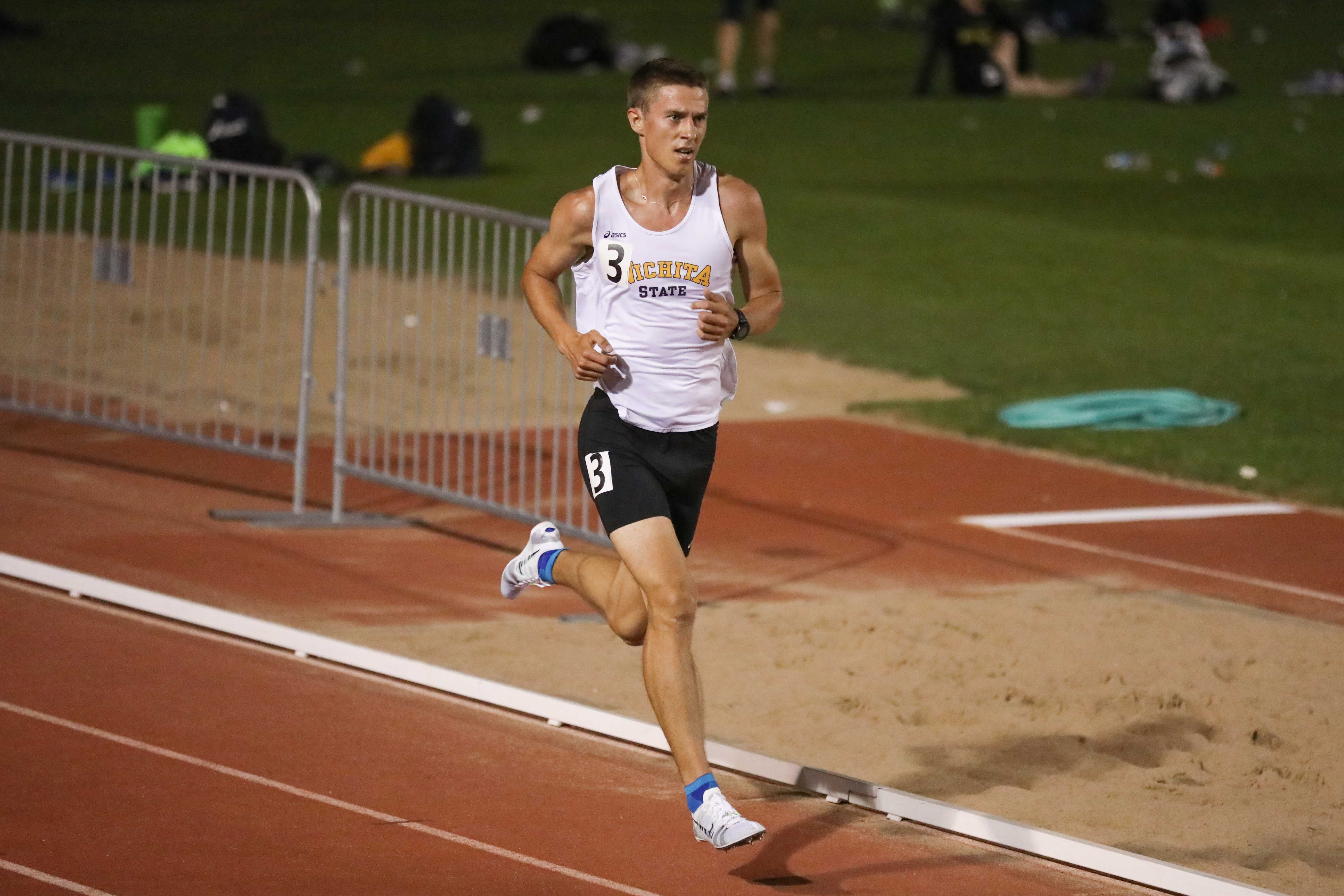 Senior distance runner Ugis Jocis races toward the finish line in the 5,000 meter run at the KT Woodman Classic on Friday night. Jocis won the race and claimed his U.S. personal record with a time of 14:35.55. (Apr. 14, 2017)