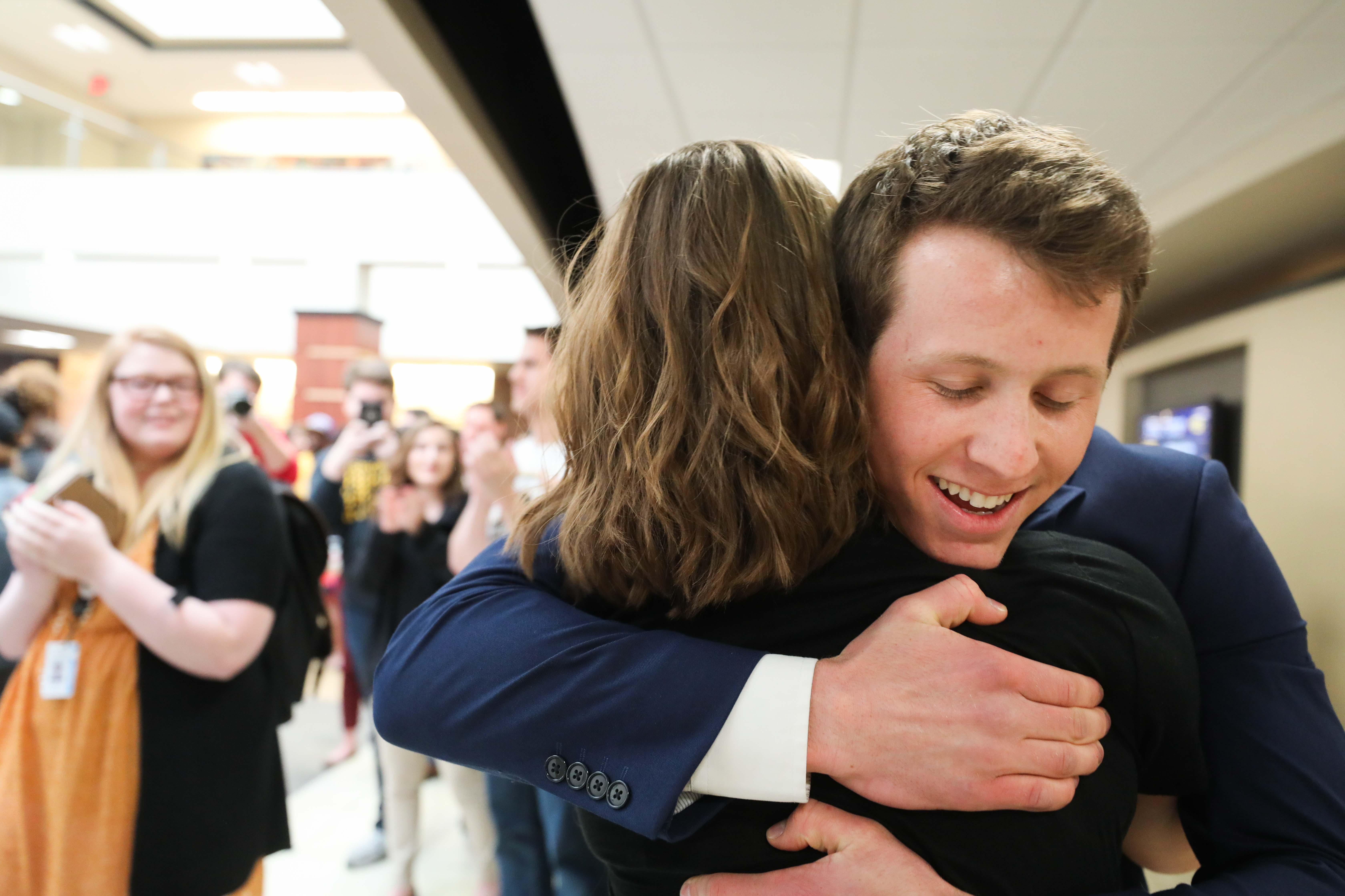 Vice President-elect Breck Towner hugs running mate Paige Hungate after the announcement of their victory in the RSC.