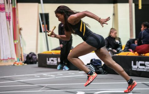 Daysha Bullocks leads off the Wichita State A squad in the 4 by 400 meter relay. Wichita State won the race.