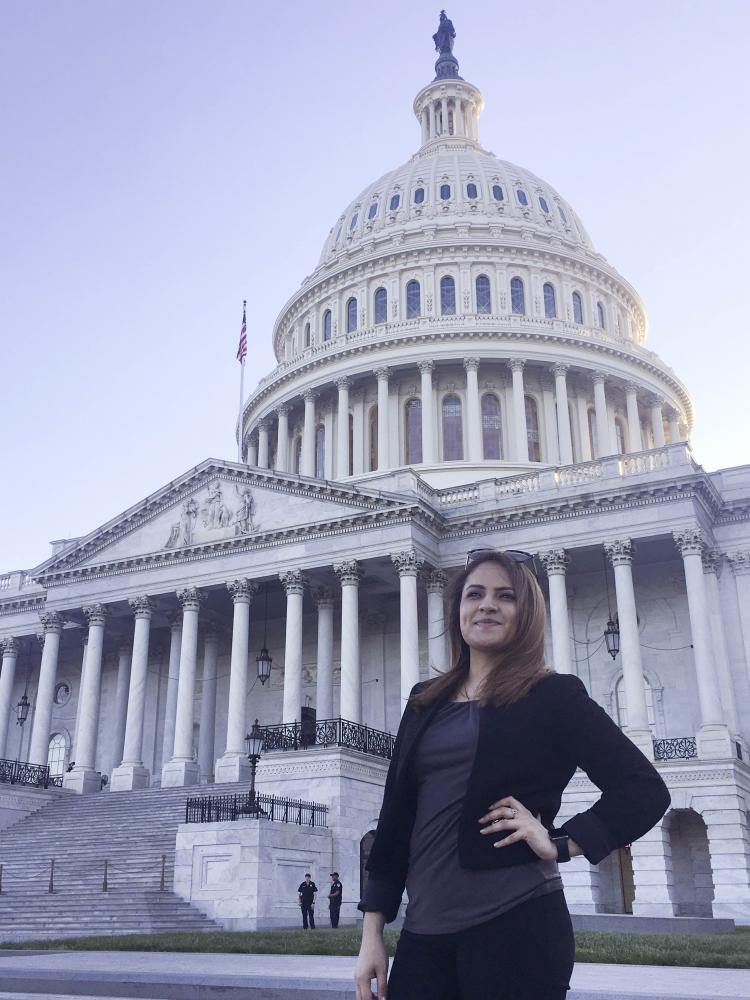 Senior Arely Navarette poses in front of the Capital Building in Washington, D.C.