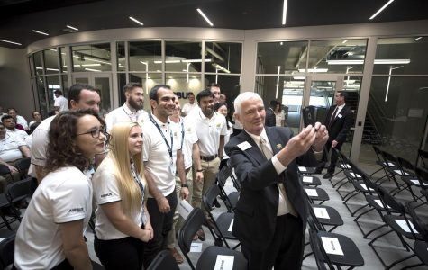 President John Bardo takes a selfie with students at the AirBus Americas grand opening last week.