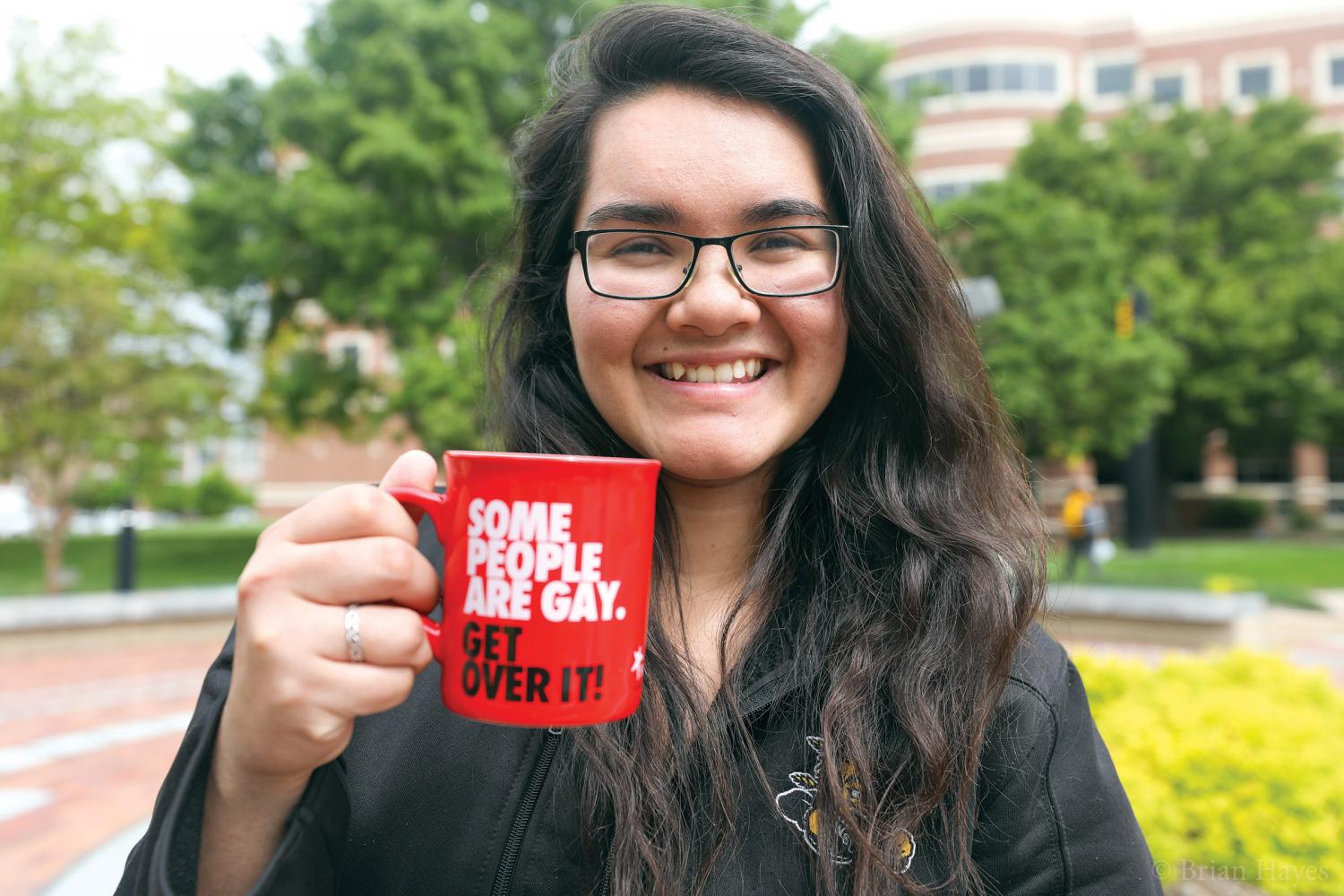 Christine Fuston poses with her favorite mug. Fuston recently spoke at TEDxWichitaStateUniversity about coming out as a lesbian.