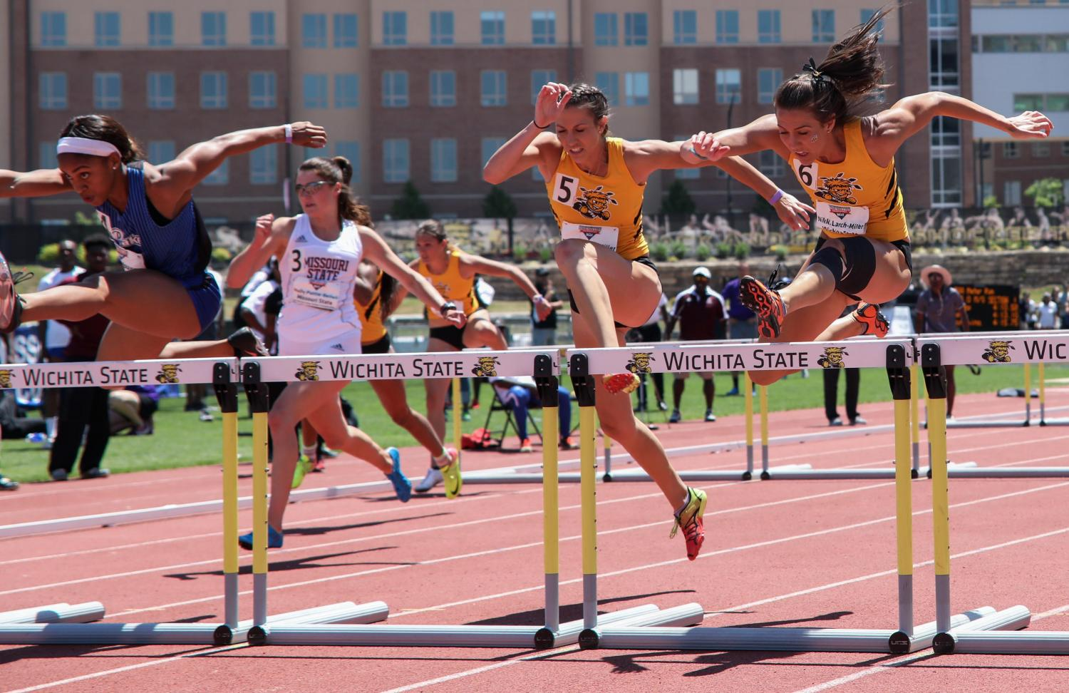 Nikki (6) and Taylor (5) Larch-Miller try to catch Mary Young in the 100 meter hurdles Sunday at the Missouri Valley Conference Outdoor Track and Field Championship. Young placed first followed by Nikki then Taylor. (May 14, 2017)