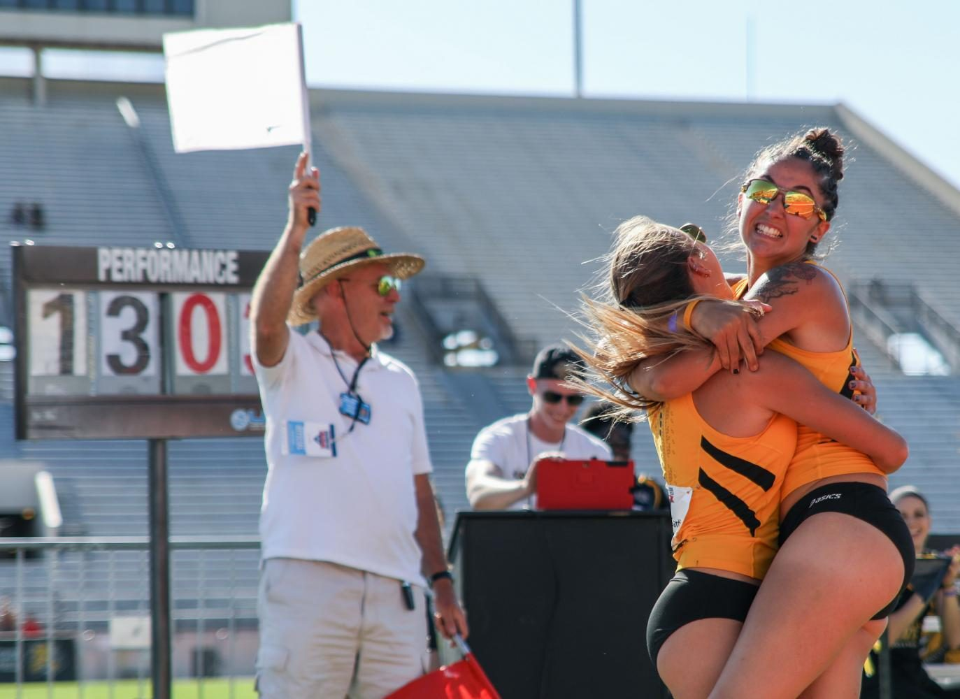 Alesa Frey hugs teammate Emily Gardiner after pole vaulting a personal record of 13 feet 3.75 inches Friday at the Missouri Valley Conference Outdoor Track and Field Championship. Frey won the event. (May 12, 2017)