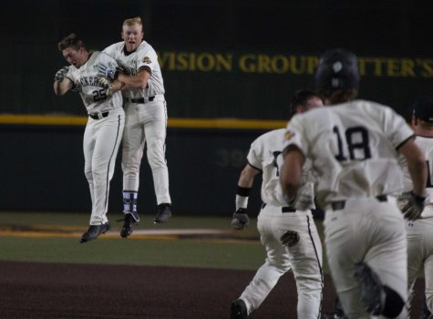 Wichita State sophomore Greyson Jenista celebrates with teammate Dayton Dugas after hitting a walk-off single against Oral Roberts.