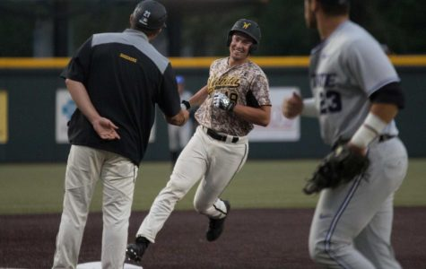 Wichita State sophomore Luke Ritter smiles at assistant coach Brian Walker after hitting a walk-off home run to beat K-State 3-2 Tuesday evening at Eck Stadium.