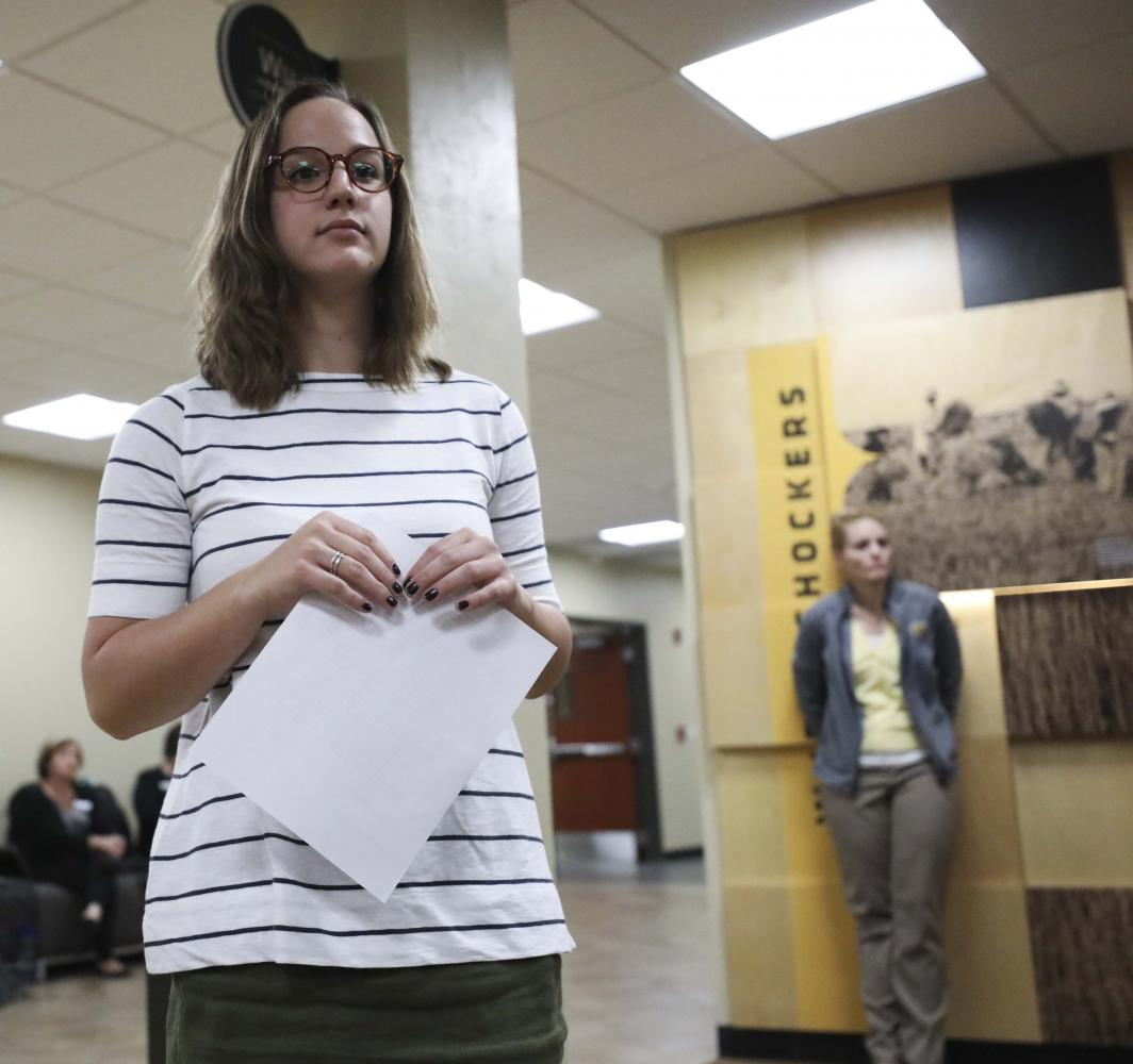 Student Body President Paige Hungate responds to a list of demands presented to her outside the Student Government Association offices.