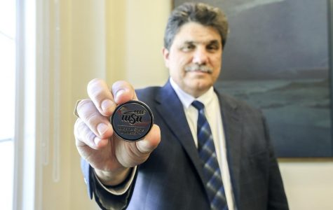 WSU Provost and Senior Vice President Anthony Vizzini holds one of the challenge coins given to graduates during the ceremony. Dr. Vizzini said he always carries one in his pocket.