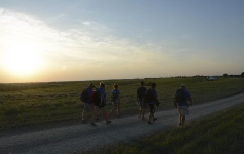 Student journalists get their hands dirty in the Flint Hills — and their feet