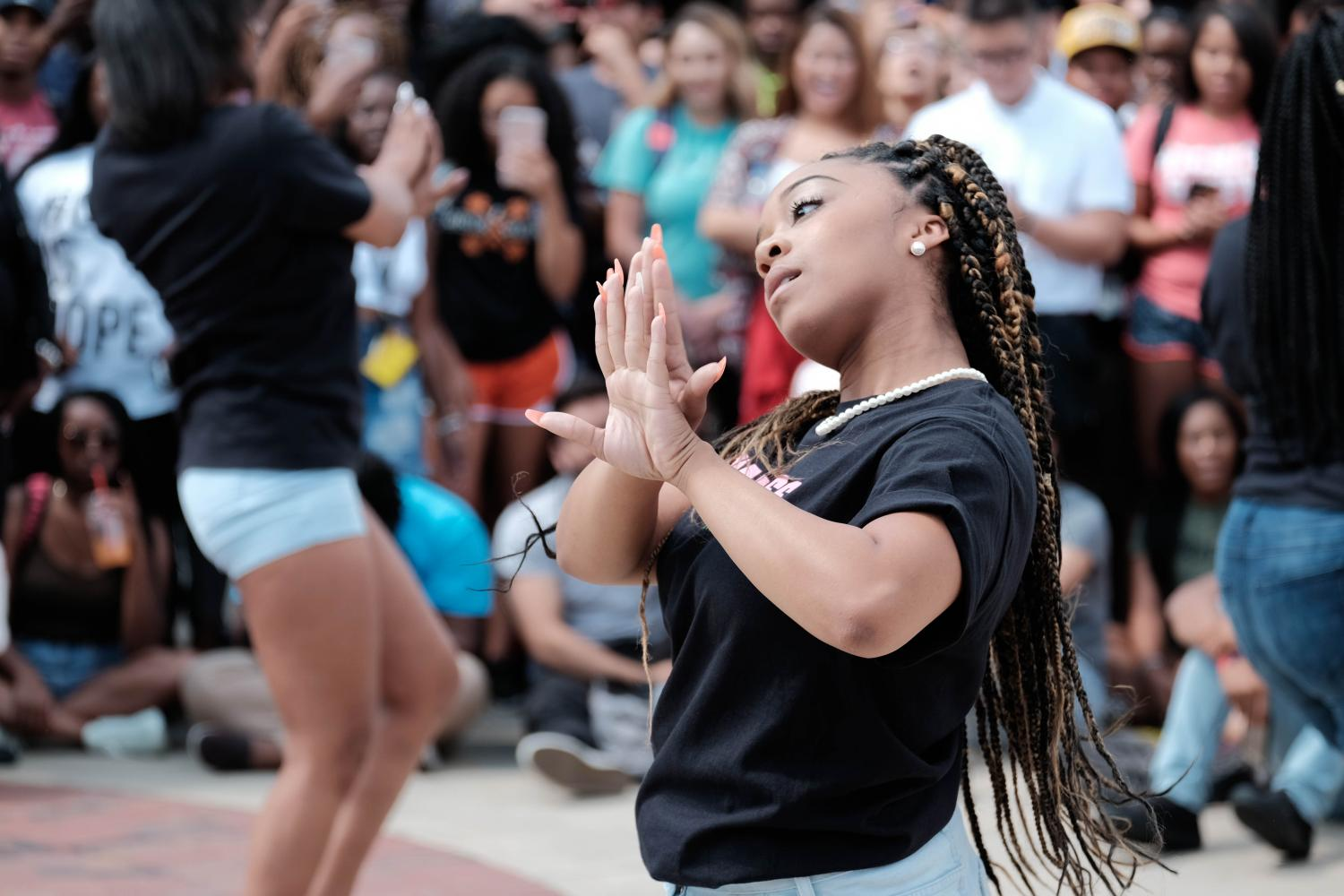 Alexus Scott, a member of Alpha Kappa Alpha Sorority , dances at the Multicultural Council Step Show
