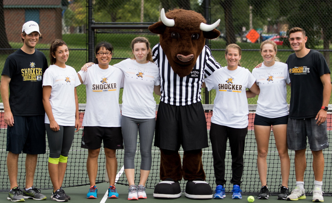 Wichita+State+Women%27s+Tennis+team+poses+with+Barry+the+Bison+before+the+free+clinic+at+the+new+courts+in+Fairmount+Park.