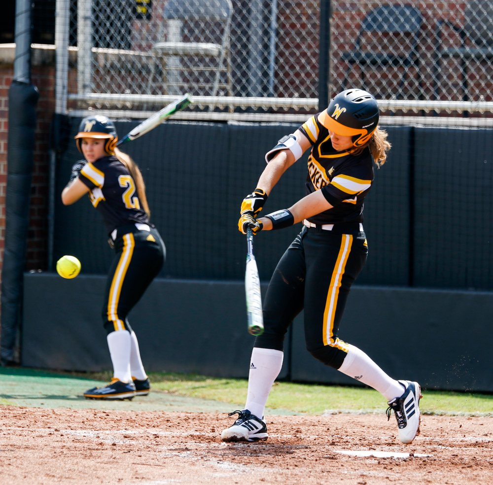 Wichita+State%27s+Neleigh+Herring+%2811%29+swings+at+a+ball+Saturday+afternoon+at+Wilkins+Stadium.+%28Sept.+16%2C+2017%29
