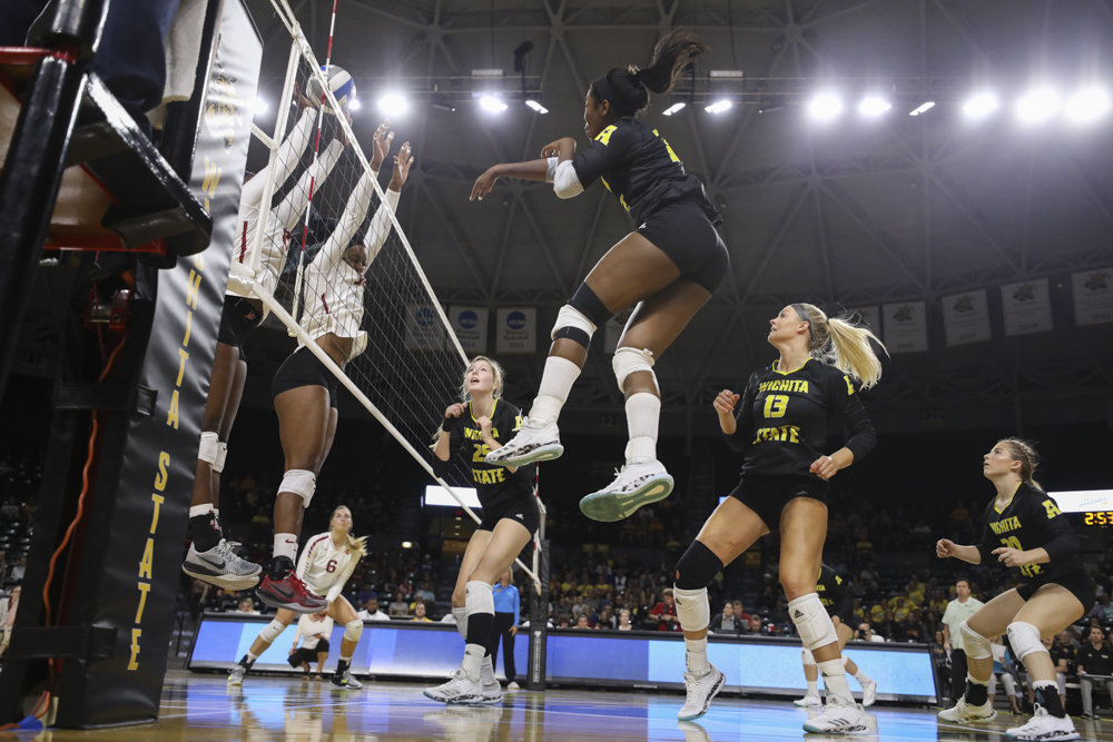 Wichita+State+outside+hitter+Tabitha+Brown+%2810%29+spikes+the+ball+agasint+two+Iowa+State+players+during+the+match+in+Koch+Arena+on+Sunday+afternoon.+%28Sept.+17%2C++2017%29