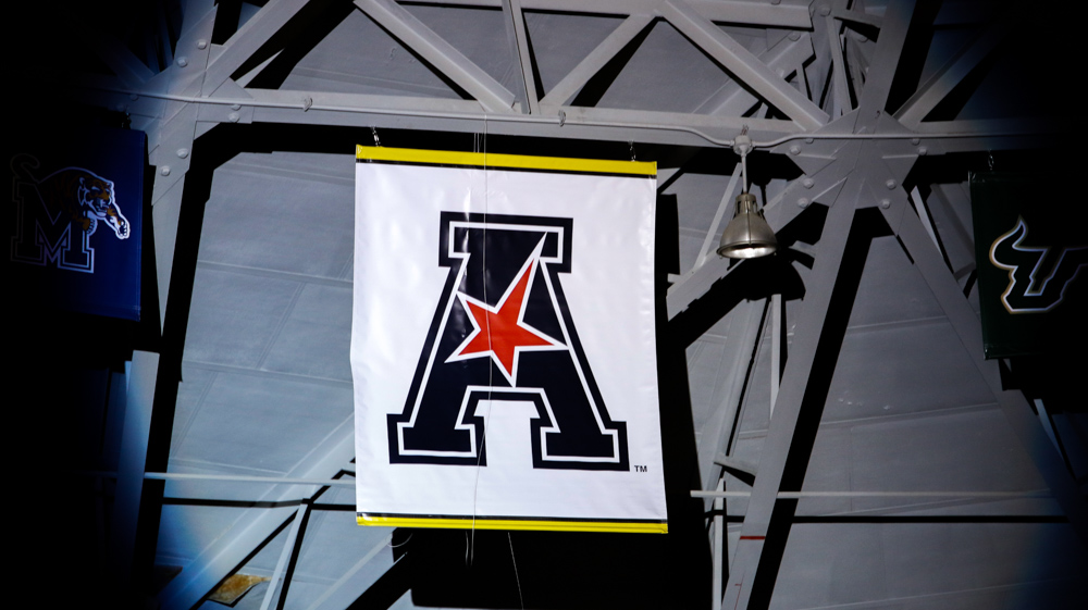 The American Athletic Conference banner is dropped during the State of The American pep rally.
