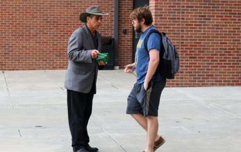 FILE PHOTO: Ed Bogner speaks to students by Shocker Hall and gives out free copies of the New Testament.
