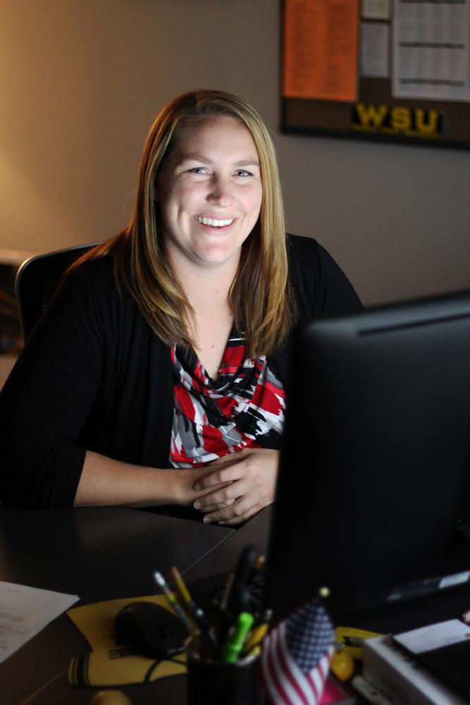 Sarah Sell, director of veteran student services, poses for a photo in her office.