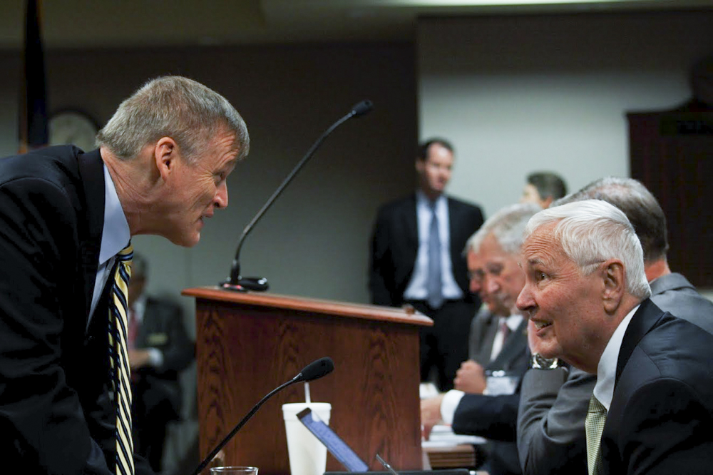 President John Bardo, right, talks with Vice President of Finance and Administration Werner Golling at a KBOR meeting in Topeka last school year.