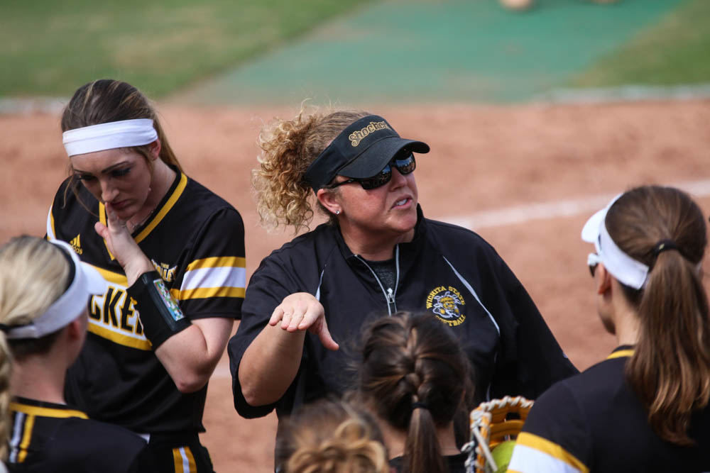 Wichita State's head coach Kristi Bredbenner encourages players at the top of the fourth against Newman University in Wilkins Stadium (Sept. 30, 2017)