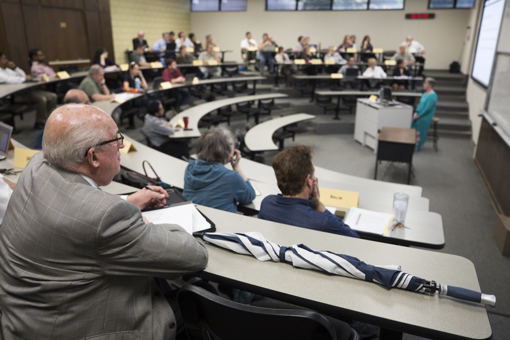 A Faculty Senate meeting held in October. The senate meets twice a month in Clinton Hall 126.