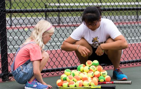 Women's tennis showing up to serve at Fairmount community cookout Saturday