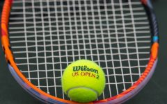 A tennis raquet and ball on the court at the new courts in Fairmount Parks.