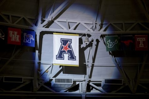 The AAC banner is unveiled during the State of the American event in Koch arena.