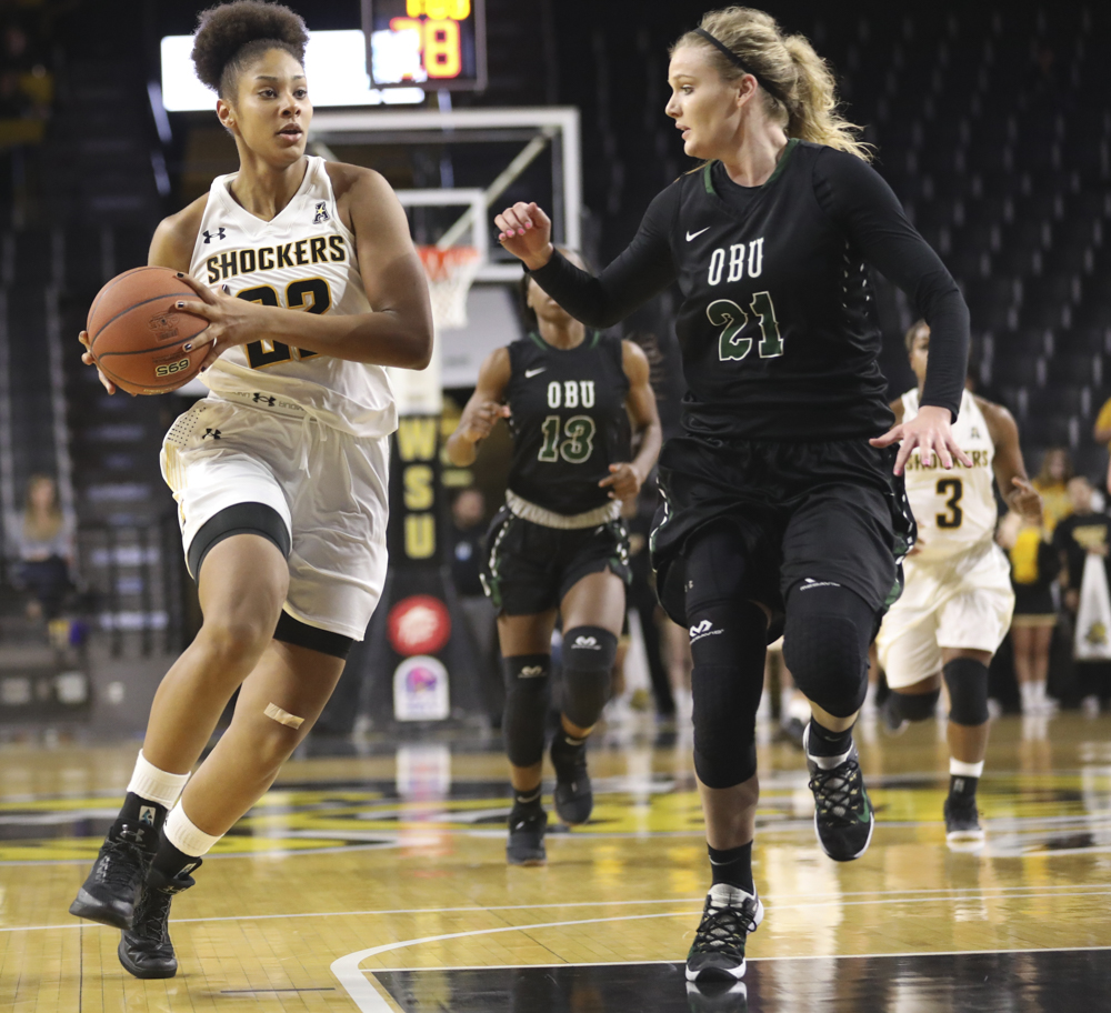 Wichita State forward Alyssia Faye drives towards the rim against OBU's Tasha Edge.