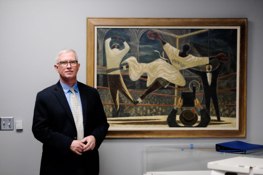 Bob Workman with one of his favorite paintings, Fletcher Martin's