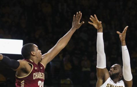 Wichita State Shockers center Shaquille Morris sinks a three-point bucket over a Charleston Cougars defender in the first half of the game against in Koch arena.