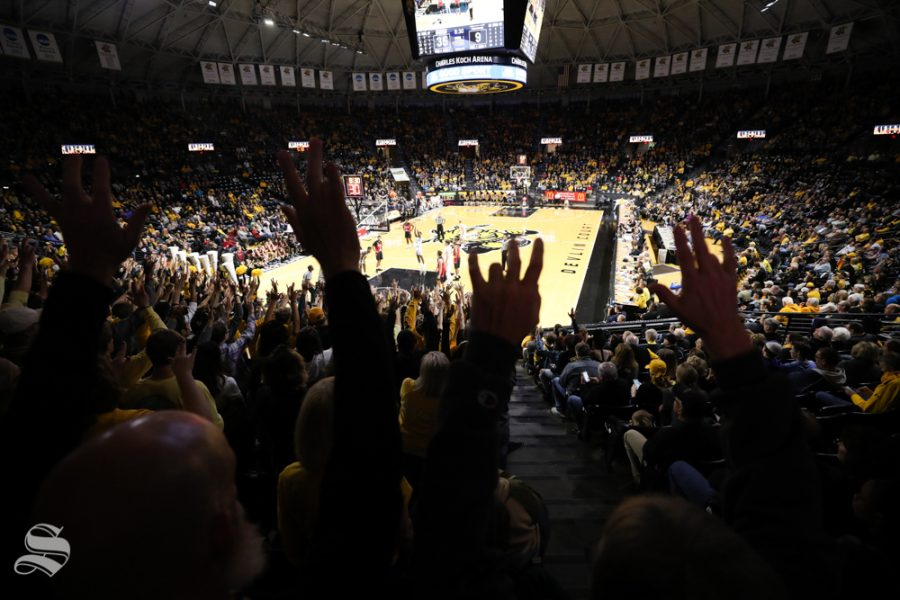 Wichita+State+fans+holds+up+the+shockers+during+the+exhibition+opener+against+Henderson+State+in+Koch+Arena.