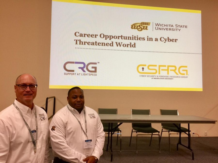 Matt Forney, left, with Wichita State and Mershard Frierson, right, with Cyber Research Group.