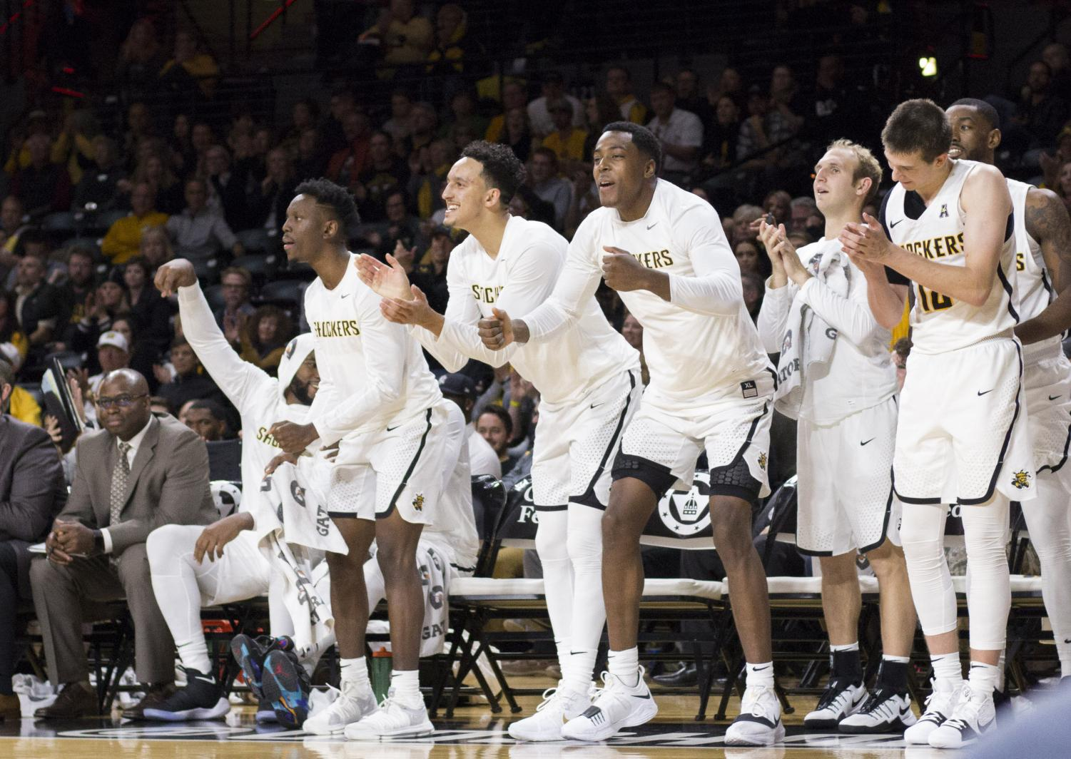 Shockers celebrate during the second half of the game against UKMC at Koch Arena.