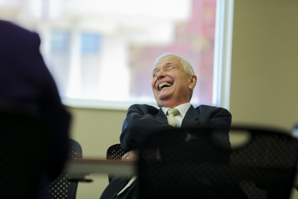 John Bardo, WSU president, laughs during the Council of Presidents during a Kansas Board of Regents meeting in the Rhatigan Student Center