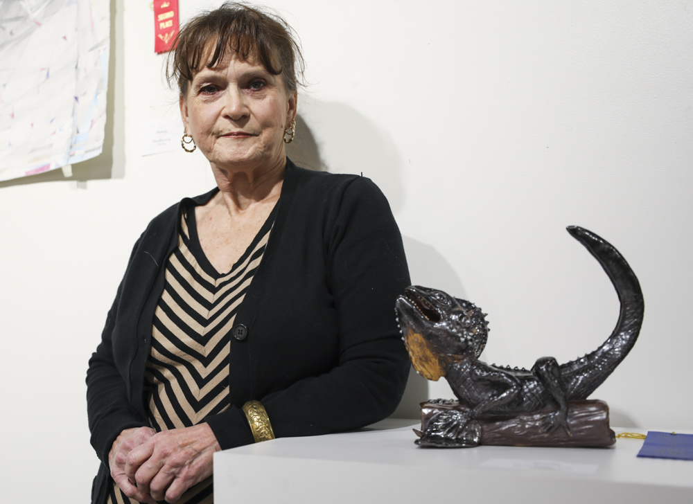 Kathy Robb stands next to her ceramic sculpture,