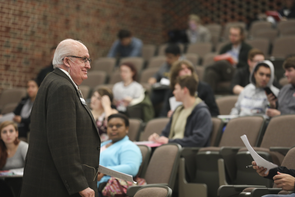 Dr. Ron Matson, dean of the School of Liberal Arts and Sciences, engages with his Men and Masculinity class.