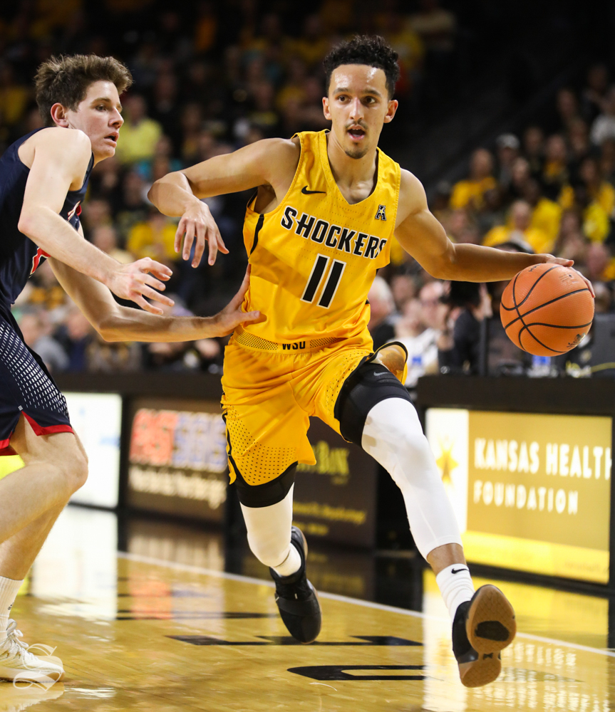 Wichita State Shockers guard Landry Shamet  breaks around a Newman defender during the charity exhibition game in Koch Arena.