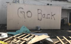 'Go Back' graffiti found on remains of burned down restaurant