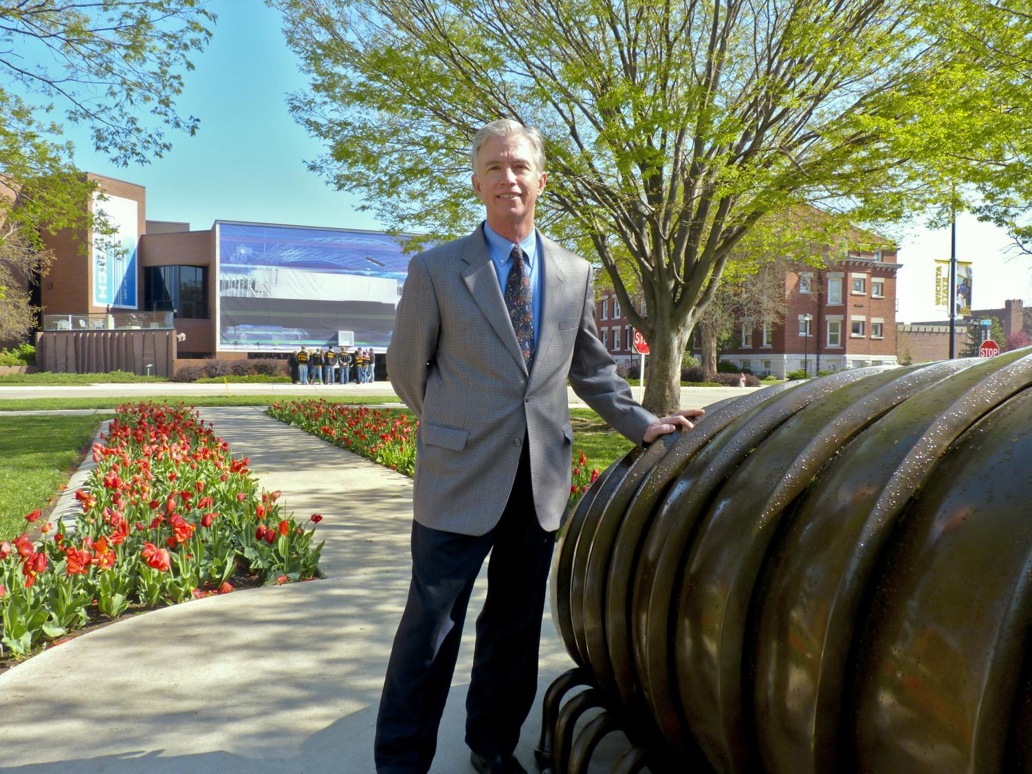 Bob Workman stands in front of the Ulrich Museum of Art, which he directs.
