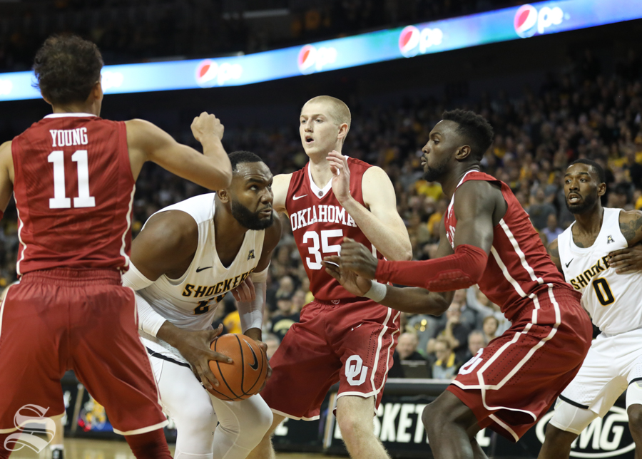 Wichita State center Shaquille Morris fights for a layup against the Oklahoma Sooners Saturday in Intrust Bank Arena.