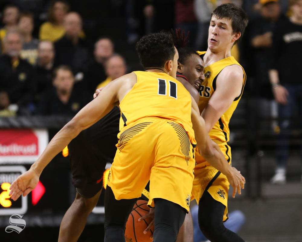Wichita State guard Austin Reaves and Landry Shamet guard Arkansas State guard Deven Simms during the second half in Koch arena