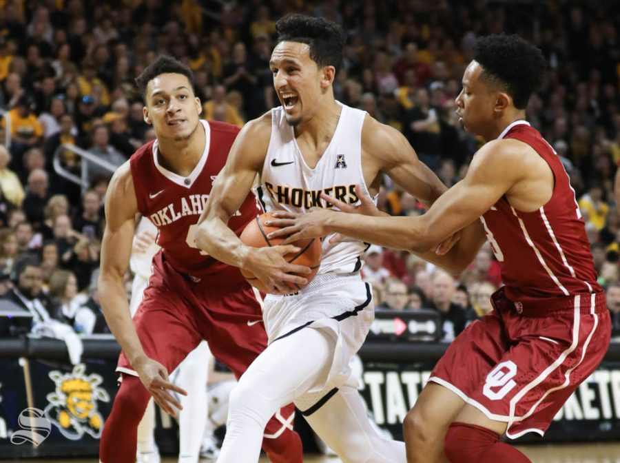 Wichita State guard Landry Shamet drives to the basket against Oklahoma center Jamuni McNeace and Oklahoma guard Jordan Shepherd during the second half in Intrust Bank Arena.
