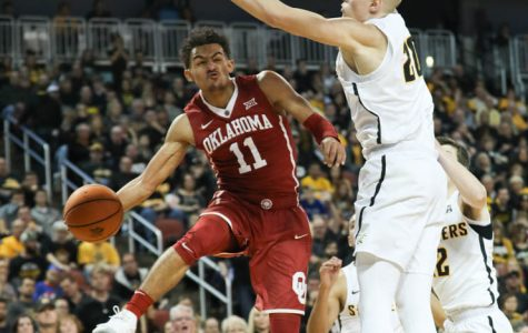 Oklahoma guard Trae Young pass around Wichita State center Rauno Nurger during the first half in Intrust Bank Arena.