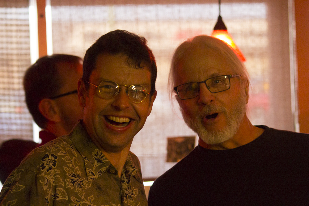 Chair of the history department Jay Price (left) and Ron Schauf (right), who played bass in local bands during the 1970's, pose for a photo at the book signing at Margarita's Cantina.