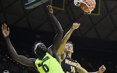 Baylor forward Jo Lual-Acuil Jr. scores on Wichita State guard Landry Shamet in the second half in Ferrel Center, in Waco, Texas.
