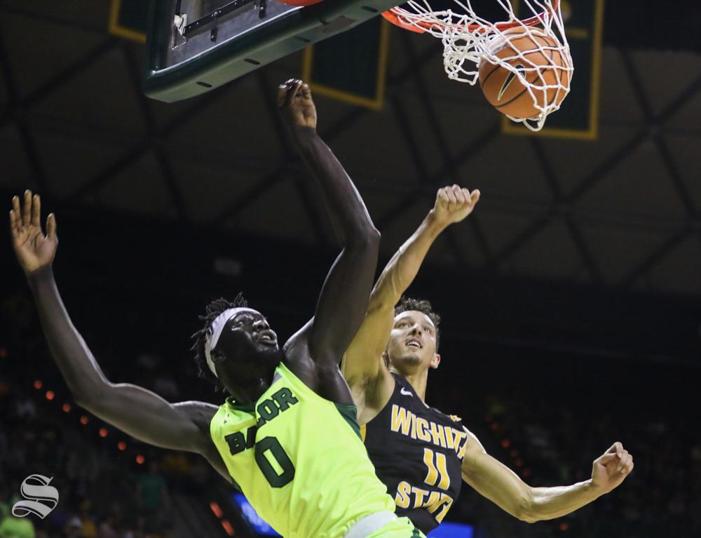 Baylor forward Jo Lual-Acuil Jr. scores on Wichita State guard Landry Shamet in the second half in Ferrel Center, in Waco, Texas.