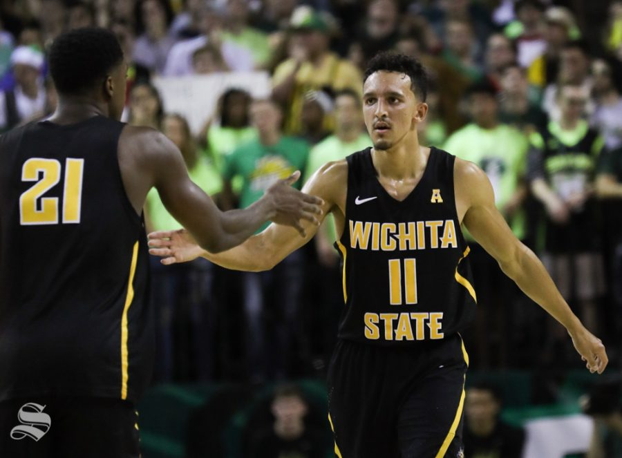 Wichita State guard Landry Shamet high fives Wichita State forward Darral Willis Jr. after sinking a three point basket against the Baylor Bears in Ferrel Center, in Waco, Texas.
