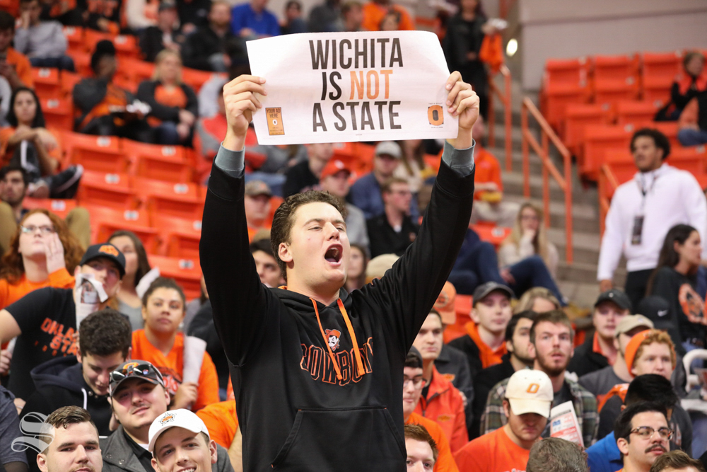 An Oklahoma State Cowboy fan holds up a sign before Wichita State tips off against Oklahoma State Cowboys in Gallagher-Iba Arena on Saturday.