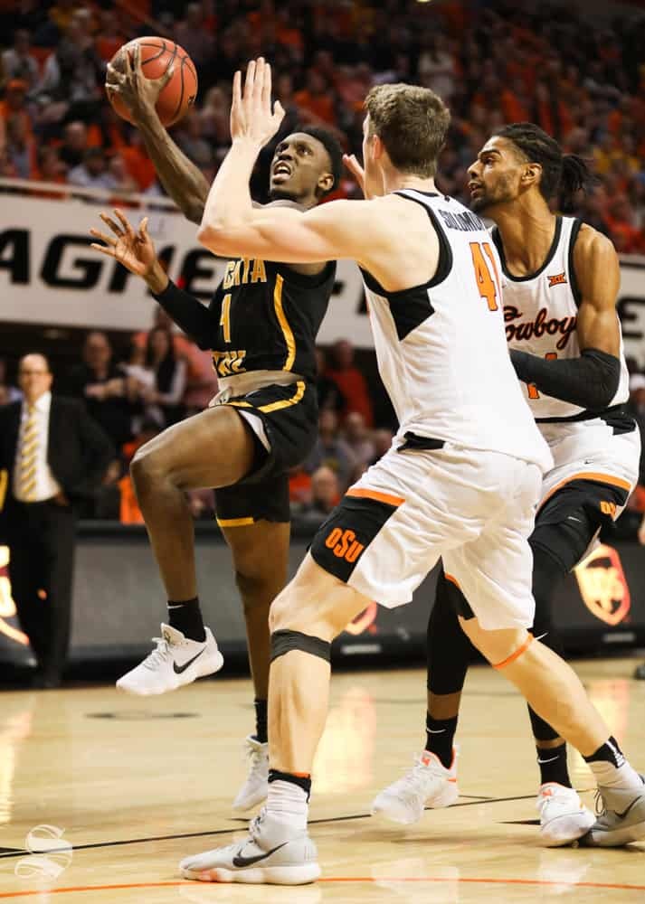 Wichita+State+guard+Samajae+Haynes-Jones+attempt+a+basket+against+Oklahoma+State+forward+Mitchell+Solomon+and+Oklahoma+State+forward+Lucas+N%27Guessan+during+the+second+half+in+Gallagher-Iba+Arena+on+Saturday.